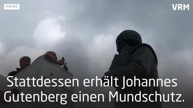 Mainz: Mundschutz für Gutenberg